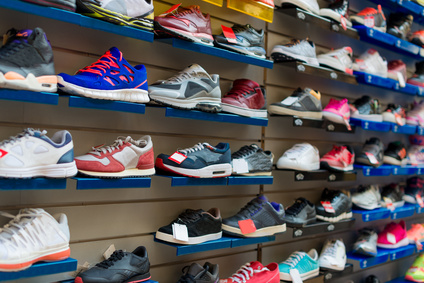 Big collection of different sport shoes.